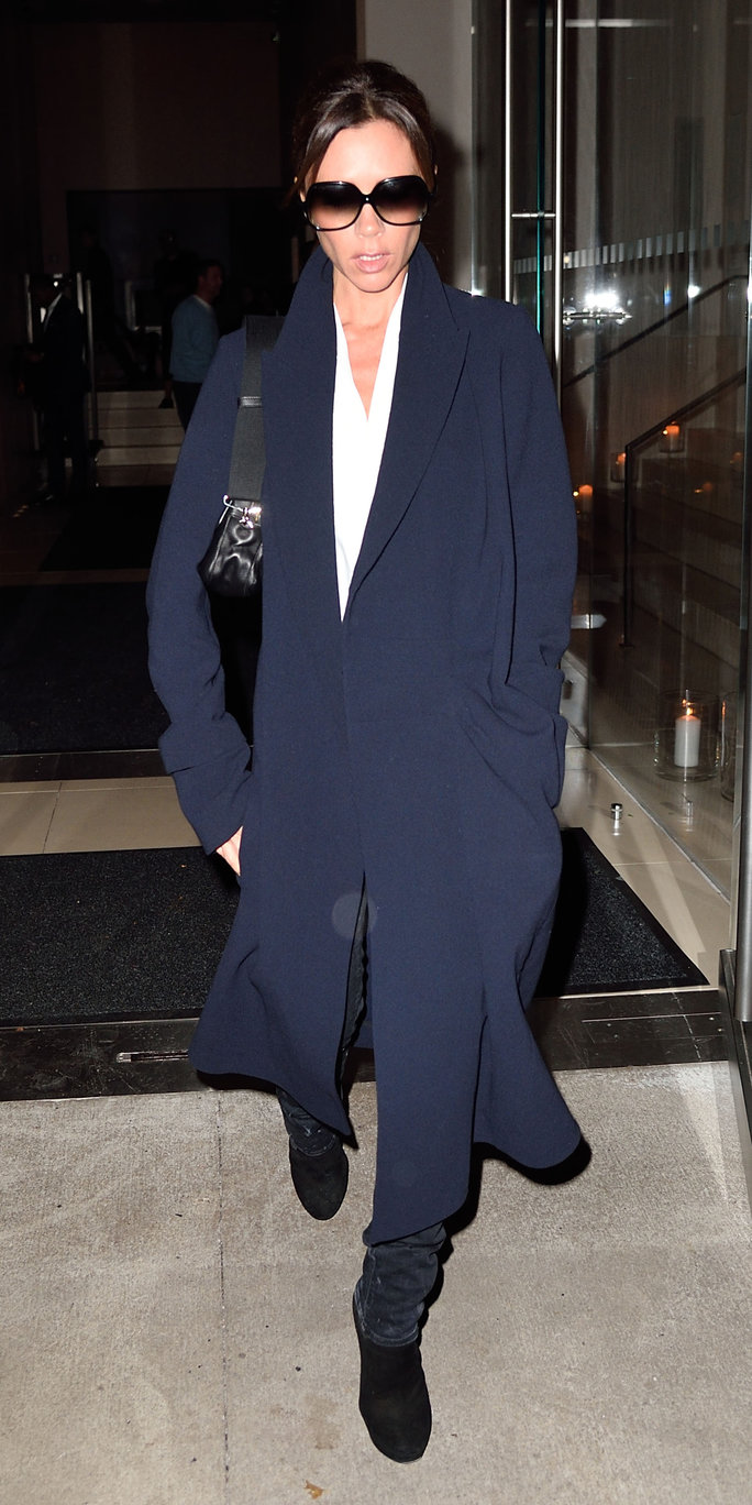 Victoria Beckham with son Brooklyn Beckham check out of their hotel in NYC. Ref: SPL1173858 101115 Picture by: Ron Asadorian / Splash News Splash News and Pictures Los Angeles:310-821-2666 New York:212-619-2666 London:870-934-2666 photodesk@splashnews.com